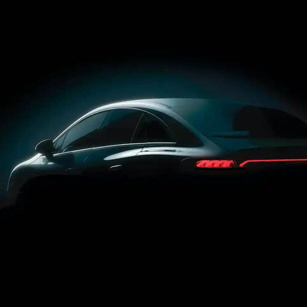 Rear of a Mercedes EQE in the dark.