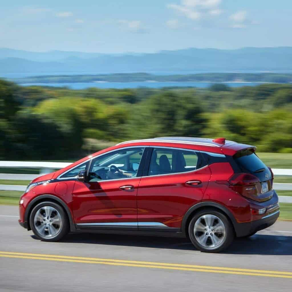 Side view of a Chevy Bolt driving.