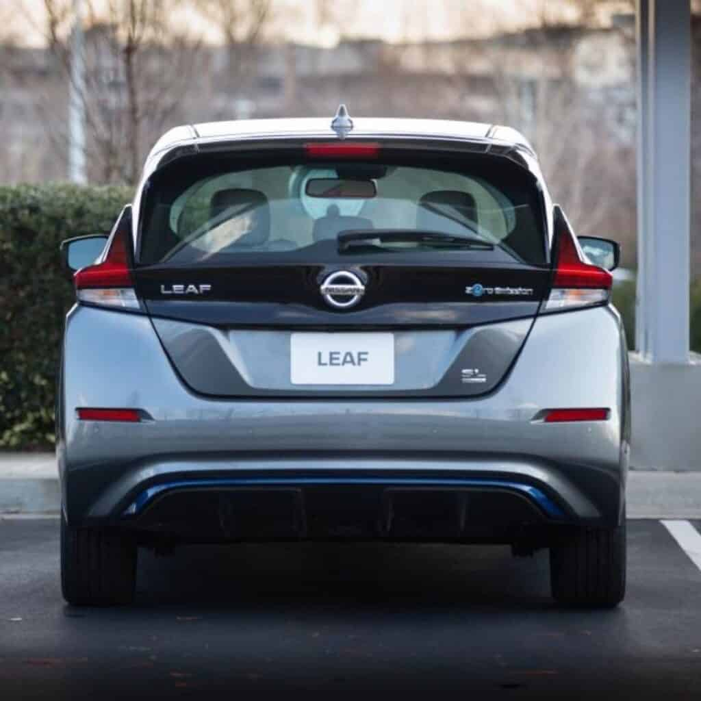Rear view of a parked Nissan Leaf.