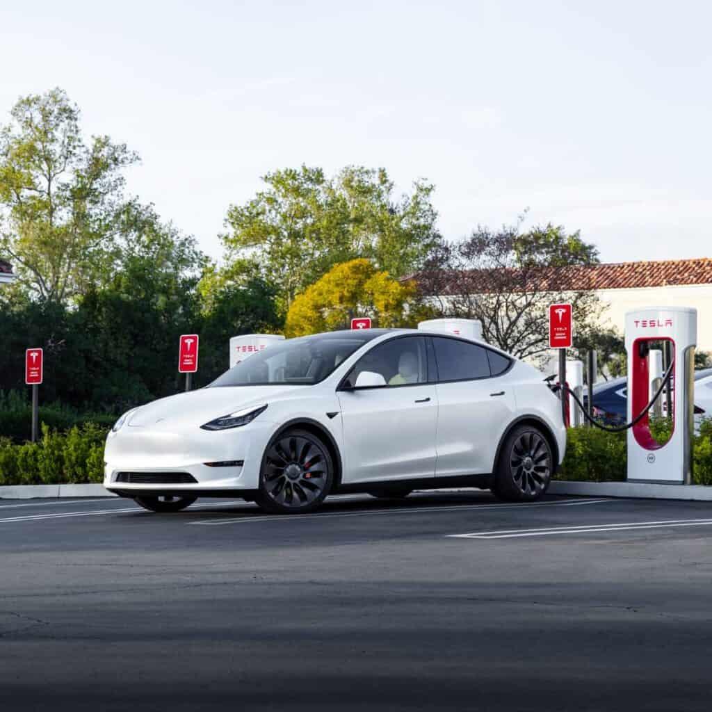 Tesla Model Y using a Supercharger.