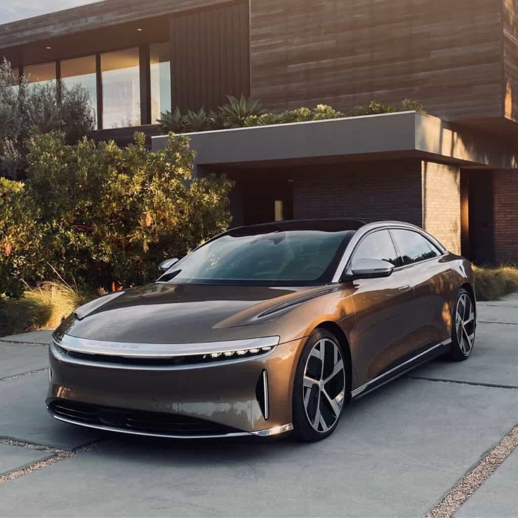 Front view of a Lucid Air parked in a driveway.